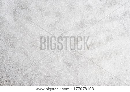 Abstract background with granulated white sugar. Closeup