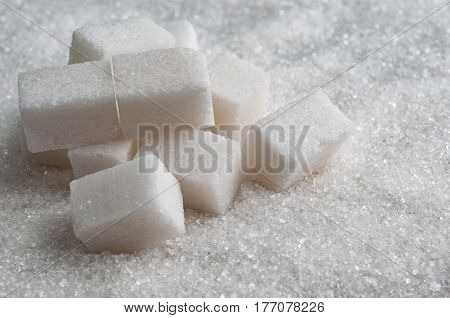 sugar background surface with cubes. Closeup view
