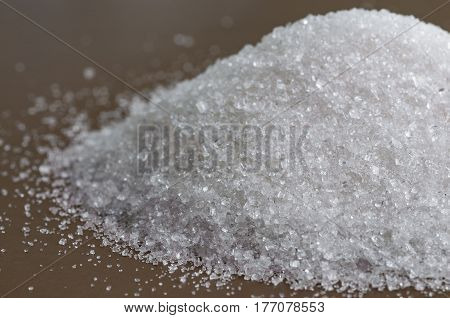 The Closeup view on granulated white sugar