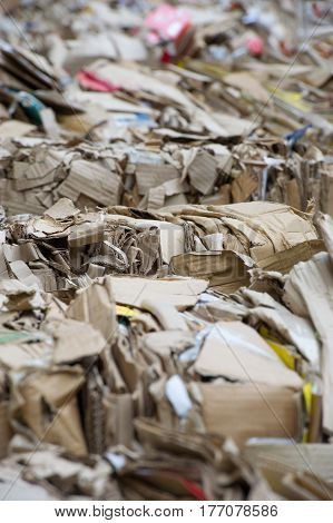 Waste paper for recycling. Heap of waste paper with strapping wire ties
