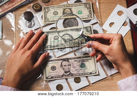 Set Of Dollars In The Pockets Through The Magnifying Glass