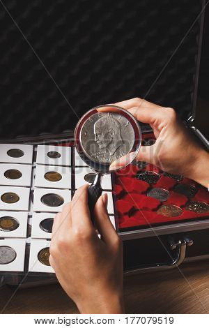 Dollar Coin In The Woman's Hand Through The Magnifying Glass