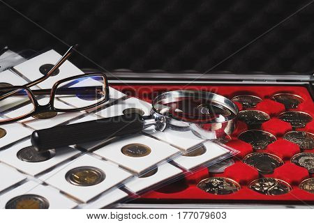 Box With Collectible Coins And Magnifying Glass