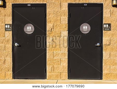 His or Hers Unisex Signs On Local Restrooms