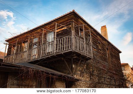 NESEBAR, BULGARIA - February 05, 2017: Old Bulgarian houses in the town of Nesebar. Nesebar is a tourist resort at the Black Sea coast. In 1956 Nesebar was declared as museum city, archaeological and architectural reservation by UNESCO.