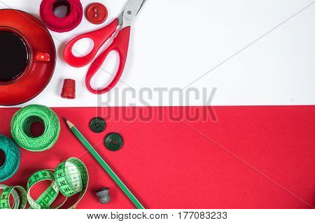 Sewing accessories in red and green colors.