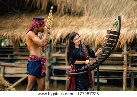 Asian beautiful girl who loves playing Pong Lang is a Thai musical instrument reed organ played by the people of the northeast of Thailand reed mouth organ