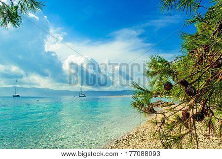 Beautiful sea view on island Brac in Croatia with yacht and rocky beach