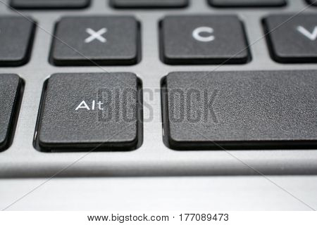 Modern laptop keyboard closeup. Alt key. Shallow depth of field.