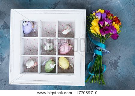 Easter tic tac toe game with eggs and rabbits in box - pastel colors and rustic style
