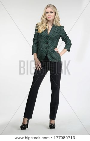 Blond Fashion Girl In Black Trousers And Blouse