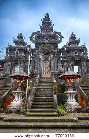 Entrance to Balinese temple Pura Besakih. Hinduism on tropical island Indonesia