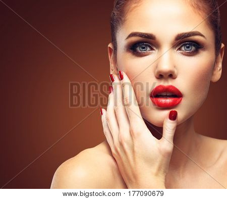 Beauty Model Woman with Long Brown Hair. Healthy Hair and Beautiful Professional Makeup. Red Lips and Smoky Eyes Make up. Gorgeous Glamour Lady Portrait. Haircare, Skincare concept