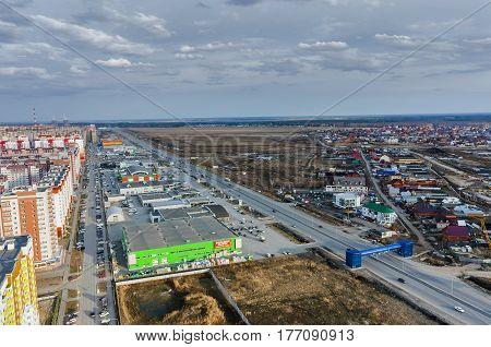 Tyumen Russia - April 19 2015: Aerial view on sleeping neighborhood and shopping centers on Fedyuninskogo street