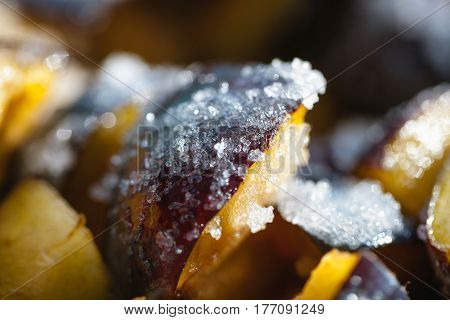 sliced plums and strewn with sugar for jam