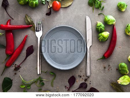 Fresh vegetables flatlay overhead frame. Food layout. Plate with vegetables