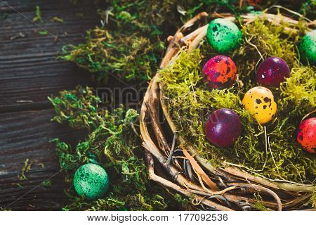 Easter. Painted Eggs on Easter table. Easter Egg in the Basket. Easter Decoration