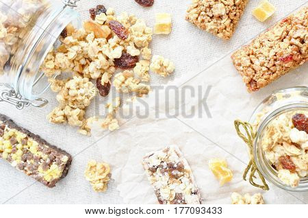 crunchy and muesli bars scattered on a table space for text background healthy food concept