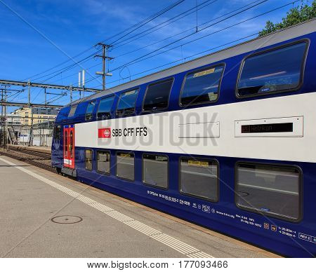 Aarau, Switzerland - 7 July, 2016: a passenger train of the Swiss Federal Railways at a platform of the Aarau railway station. Swiss Federal Railways is the national railway company of Switzerland.