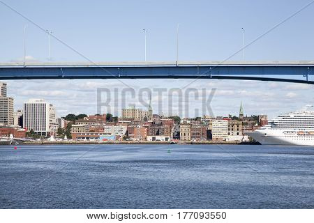 The view of a bridge and a cruise ship docked in Saint John downtown (New Brunswick Canada).