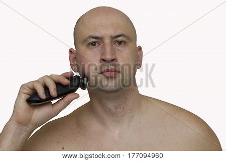 The guy with the Bodygroom on white background. Bald