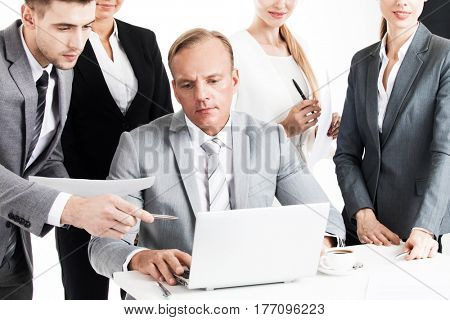 Business team working with laptop and documents together