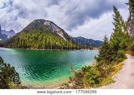 The concept of hiking. Photo taken fisheye lens. Travel to the Southern Tyrol, Italy. Walk around the Alpine lake Lago di Braies
