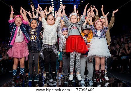 MOSCOW RUSSIA - MARCH 12 2017: Model walk runway for DETSKY MIR catwalk at Fall-Winter 2017-2018 at Mercedes-Benz Fashion Week Russia. Kid's fashion.