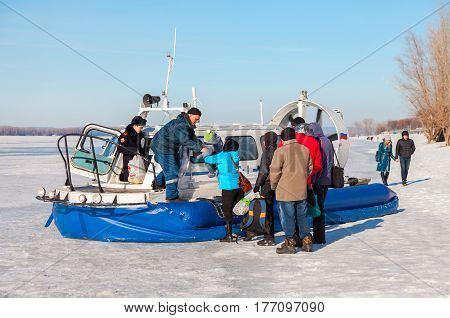 SAMARA RUSSIA - MARCH 11 2017: Embarkation people on the passenger hovercraft