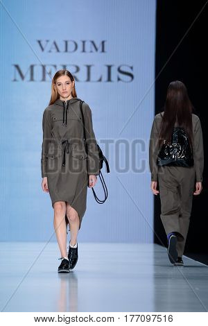 MOSCOW RUSSIA - MARCH 12 2017: Model walk runway for VADIM MERLIS catwalk at Fall-Winter 2017-2018 at Mercedes-Benz Fashion Week Russia.