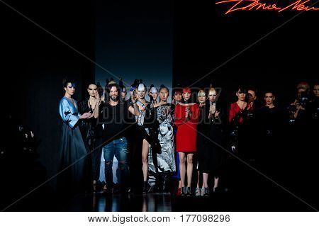 MOSCOW RUSSIA - MARCH 12 2017: Model walk runway for DIMANEU catwalk at Fall-Winter 2017-2018 at Mercedes-Benz Fashion Week Russia.