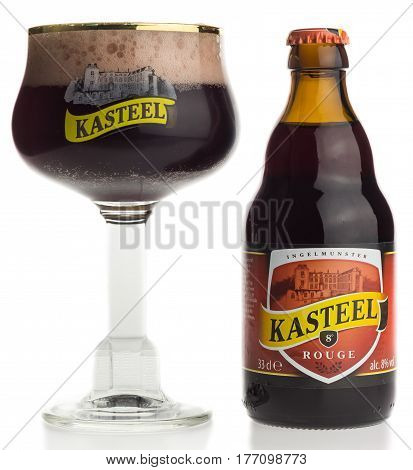GRONINGEN, NETHERLANDS - MARCH 14, 2017: Bottle and glass of Kasteel Rouge fruit beer isolated on a white background