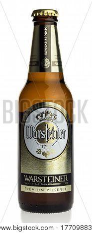 GRONINGEN, NETHERLANDS - MARCH 19, 2017: Bottle of German Warsteiner beer isolated on a white background