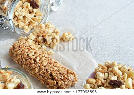 crunchy and muesli scattered on a table space for text background healthy food concept