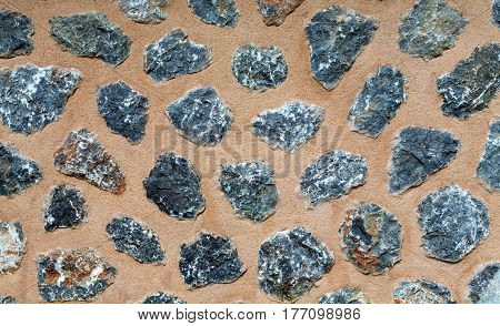 Background of the stones in the sand cement wall