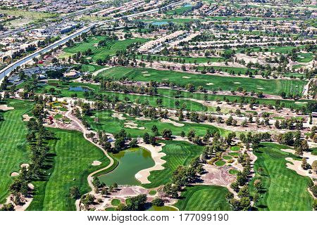 Multiple golf courses viewed from above in Arizona