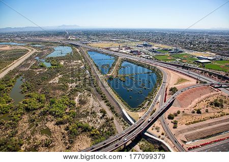 Aerial view of the bike path running beneath the Loop 101 & 202 freeways at the Salt River in Mesa Arizona looking west to east