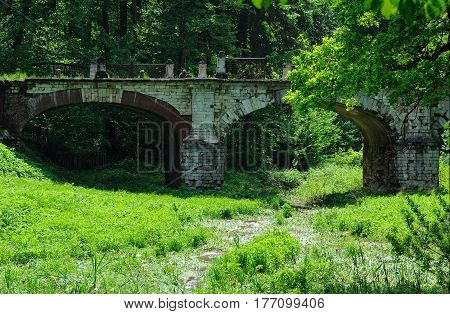 Old stone bridge in manor Serednikovo - recognized pattern of landscape and architecture of the 18th century Russia