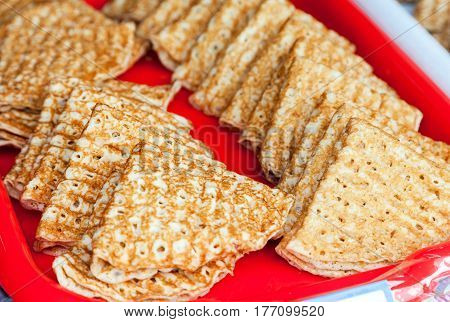 Russian traditional food. Appetizing fried pancakes ready for sale during Pancake Week