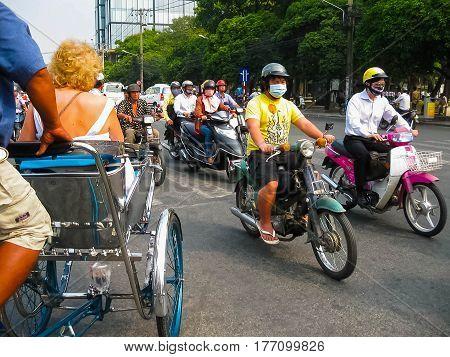 Hanoi, Vietnam - February 11, 2011: Many motorbikikes at the street in Ho Chi Minh City, Vietnam. Motorbike is a most popular transport in Vietnam.