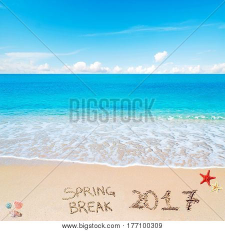 Spring break 2017 written on the sand