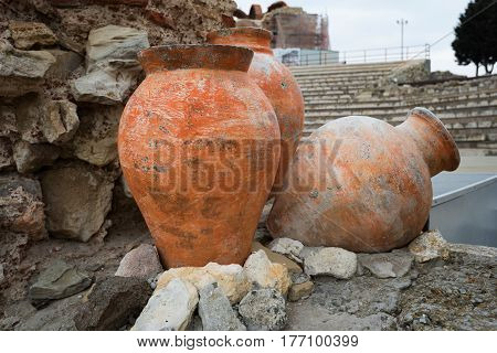 NESEBAR, BULGARIA - February 12, 2017: Ancient pots. The Church of Christ Pantocrator is a medieval Eastern Orthodox church in the Bulgarian town Nesebar. In 1956 Nesebar was declared as museum city, archaeological and architectural reservation by UNESCO.