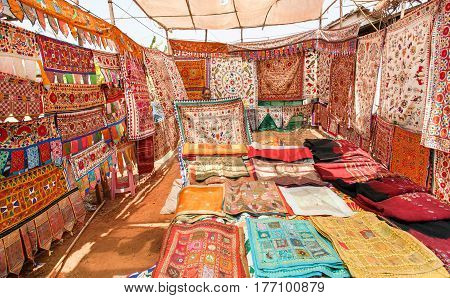 GOA, INDIA - MAR 1, 2017: Beautiful store with old carpets textile and colorful bedspreads on asian market on March 1, 2017. Near 5 million tourists visit Goa annually