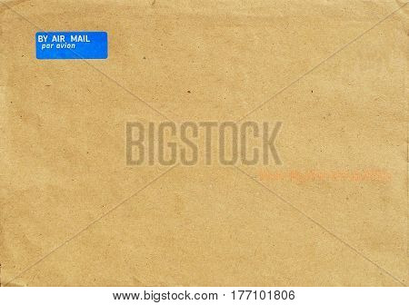 Postal envelope made of light brown recycled paper.