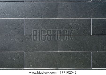 Decorative siding imitating well-done gray brick wall
