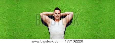 Fitness, Sport And Vacation Concept - Sportsman Relaxing Lying On A Grass In Summer Day, Handsome Ma