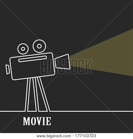 Old movie camera with reel on a dark background and a ray of light.Old movie camera with reel on a dark background and a ray of light. Symbol of the film industry, cinema.Outline.