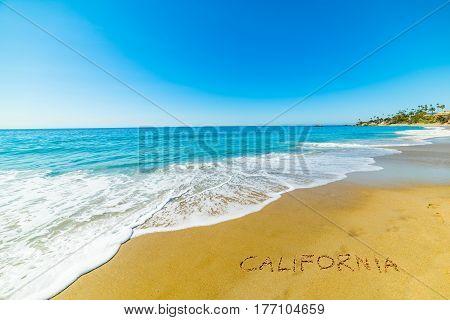 California written on the sand in Laguna Beach
