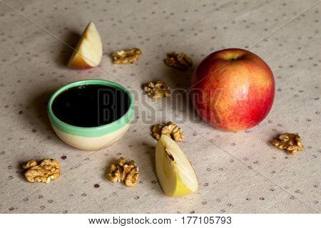 Apple honey and nuts on the table