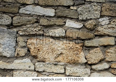 A fragment of a wall of the shell sealed with cement mortar. Texture background